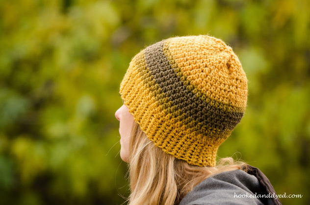 Mushroom dyed hat with green and gold